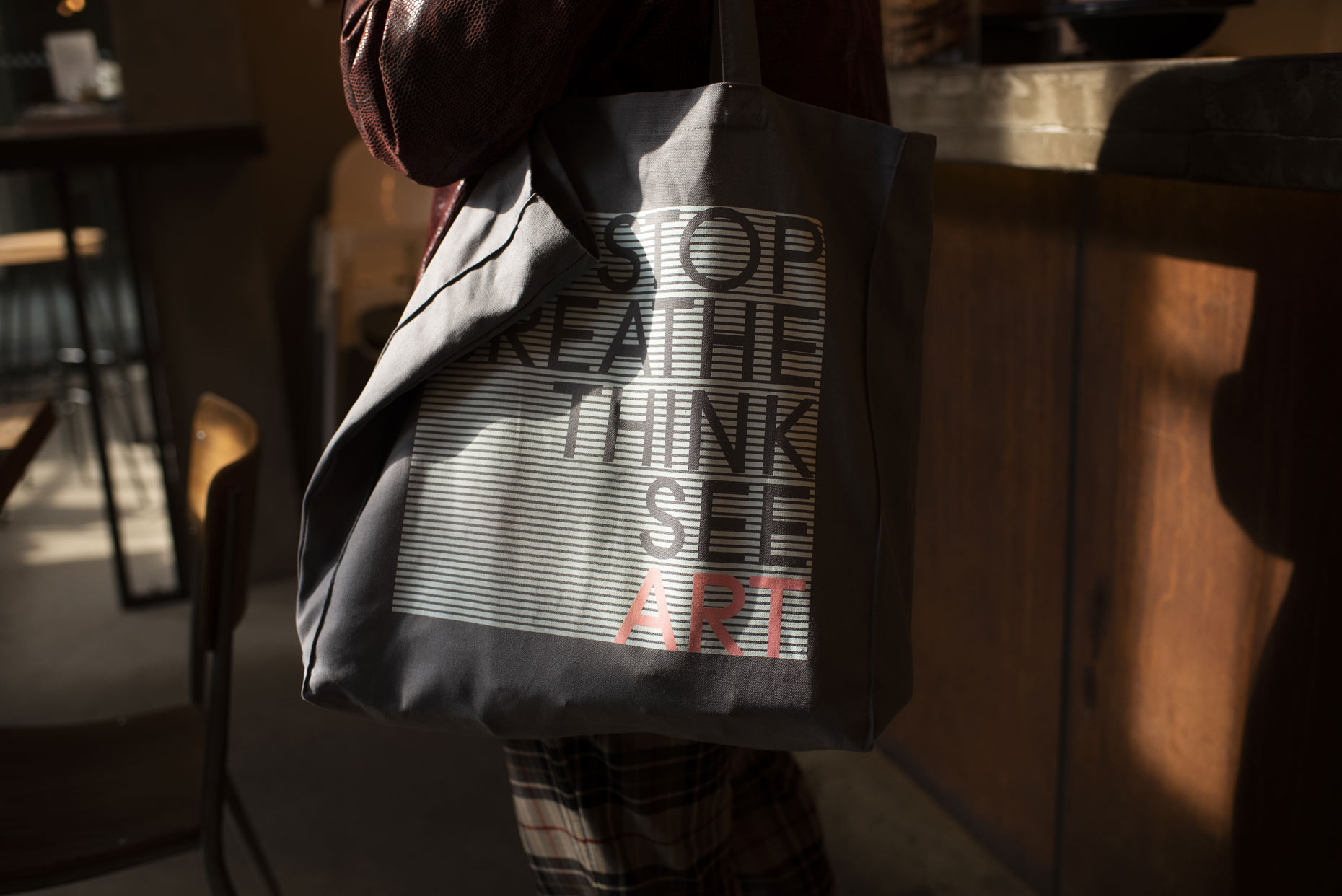 Person with Art Fund tote bag in a gallery