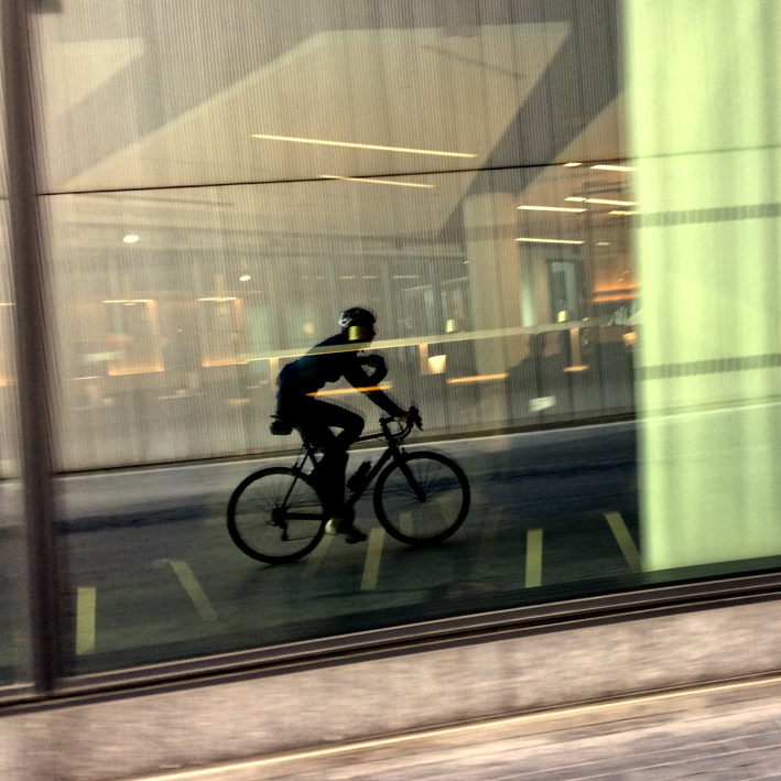 Cyclist reflection by portrait photographer London