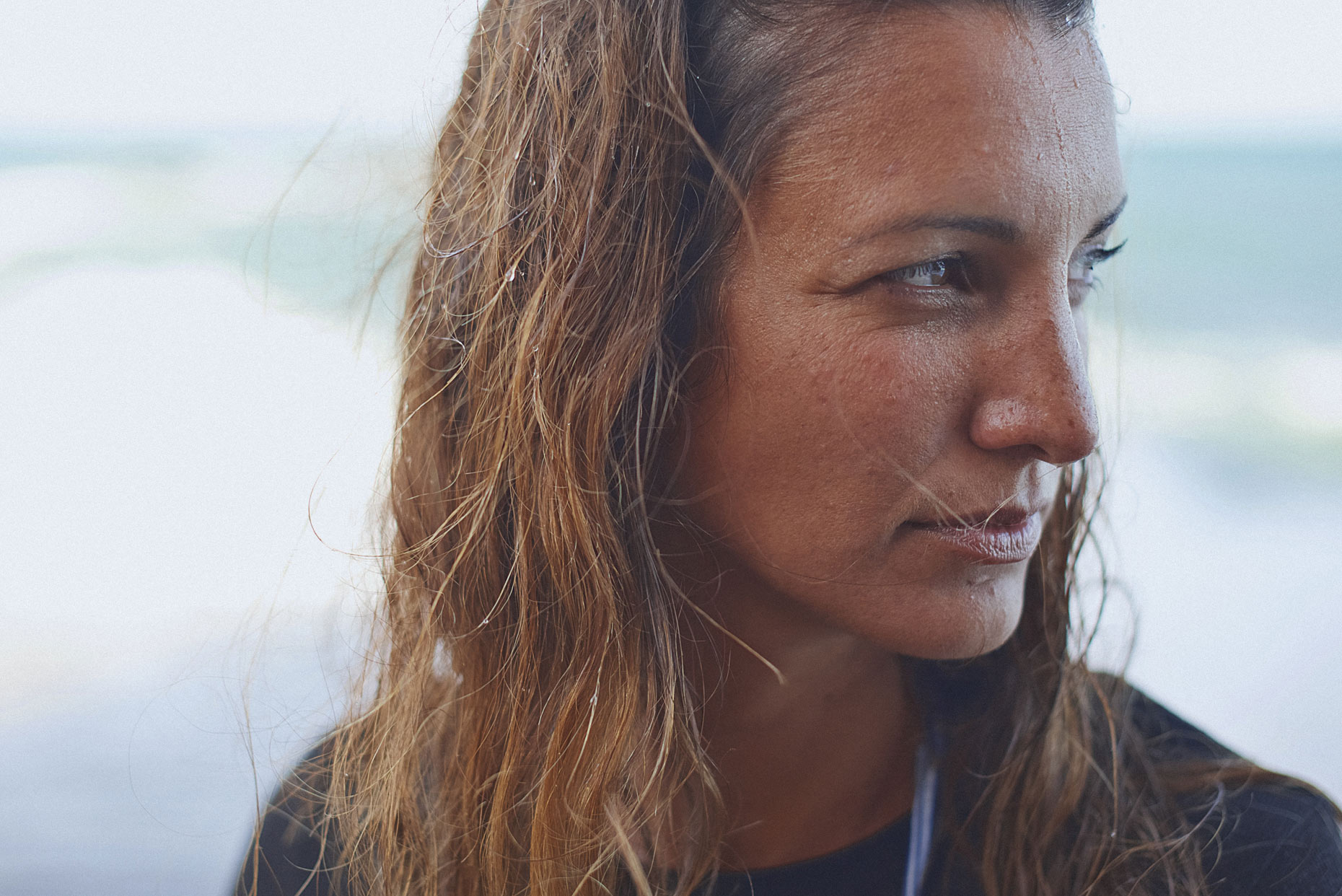 Portrait photograph of a surfer